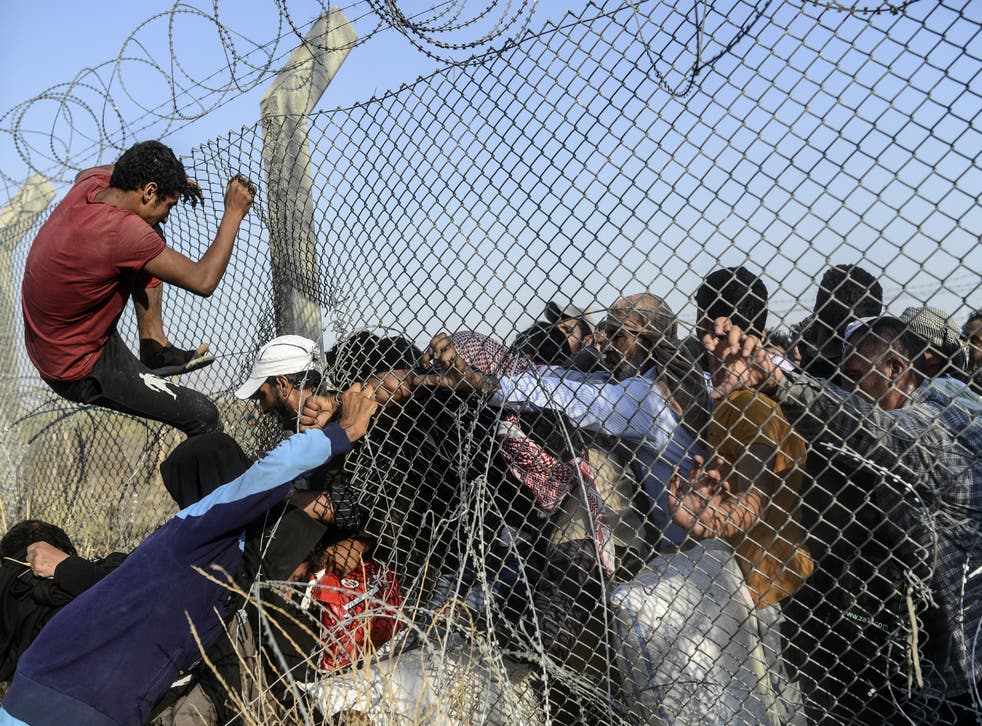 Thousands of refugees fled Syria as Isis violence continues (Photo: BULENT KILIC/AFP/Getty Images)