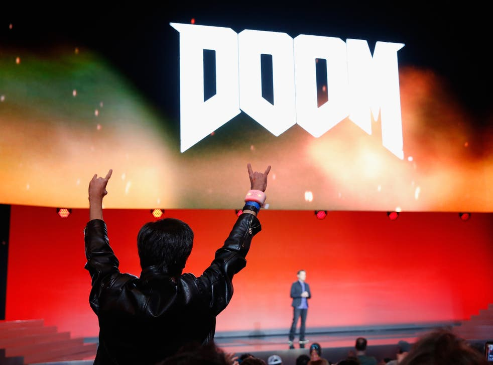 Fans cheer for Executive Producer for Id Software, Marty Stratton as he speaks about 'Doom' during the Bethesda E3 2015 press conference at the Dolby Theatre on June 14, 2015 in Los Angeles, California