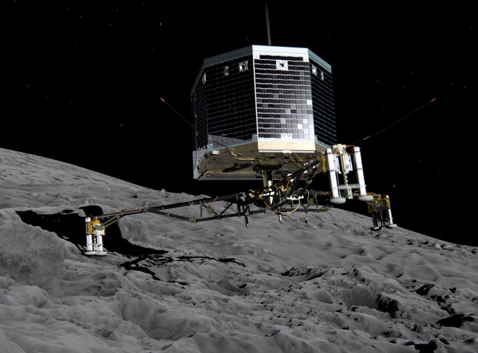 In this February 17, 2014 handout photo illustration provided by the European Space Agency (ESA) the Philae lander is pictured descending onto the 67P/Churyumov-Gerasimenko comet