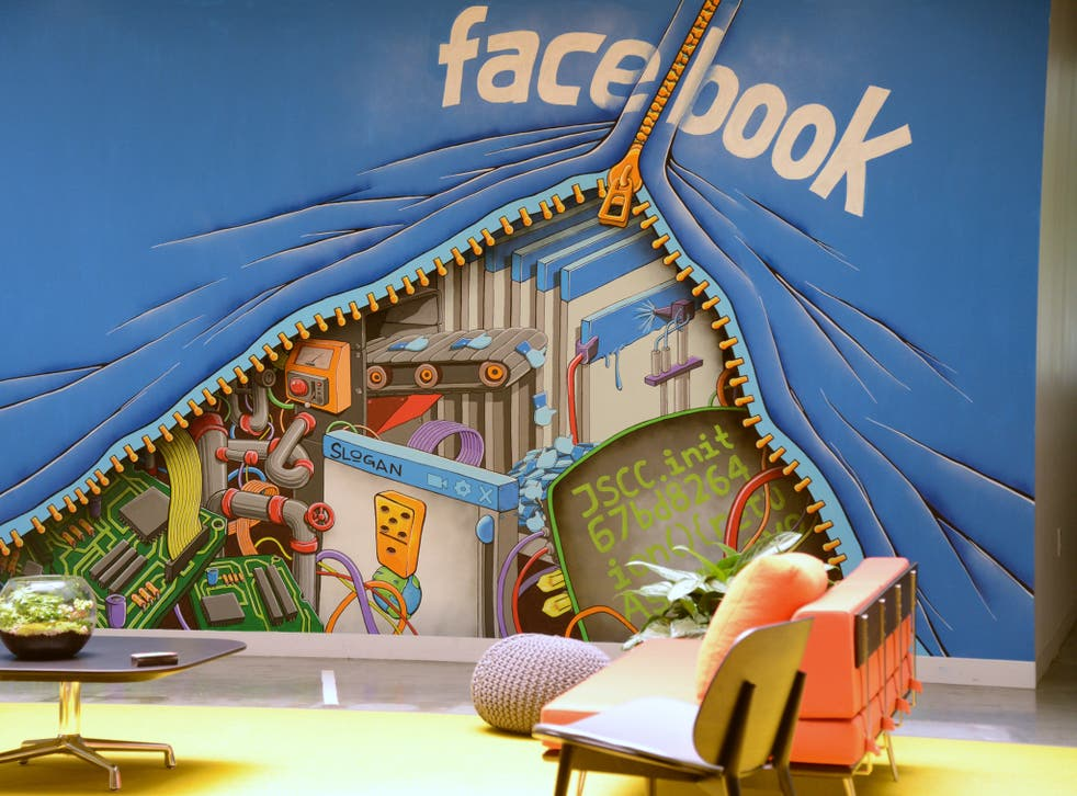 A mural decorates one of the many open space work areas at the Facebook headquarters in Menlo Park, California, May 15, 201