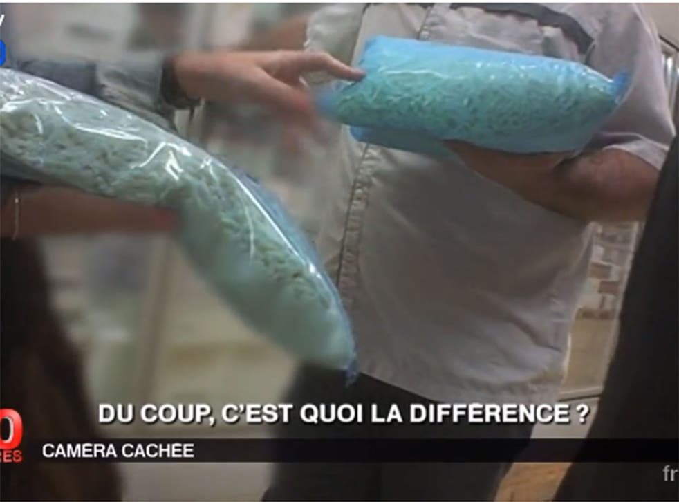 Screengrab from France 2's report showing undercover reporting inside the factory