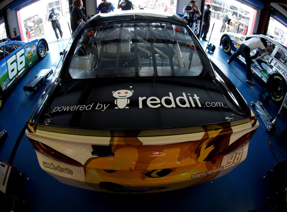 The #98 Dogecoin / Reddit.com Ford, driven by Josh Wise, is seen in the garage during practice for the NASCAR Sprint Cup Series Aaron's 499 at Talladega Superspeedway on May 2, 2014 in Talladega, Alabama