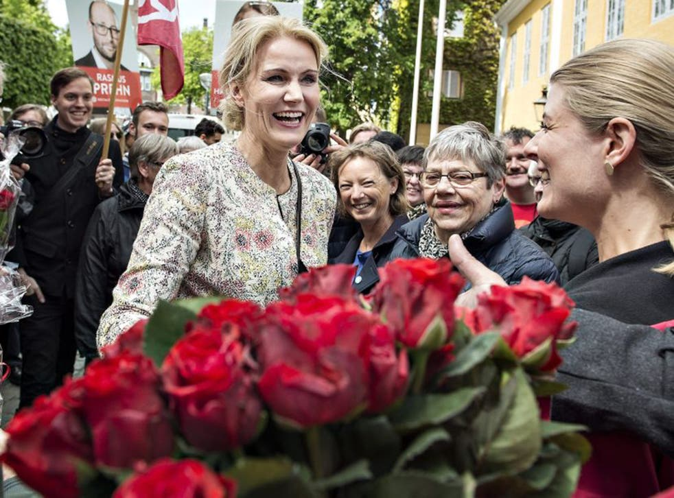 Danish Prime Minister Helle Thorning-Schmidt greets supporters holding red roses, the Social Democratic party's symbol, at a campaign stop in Aalborg