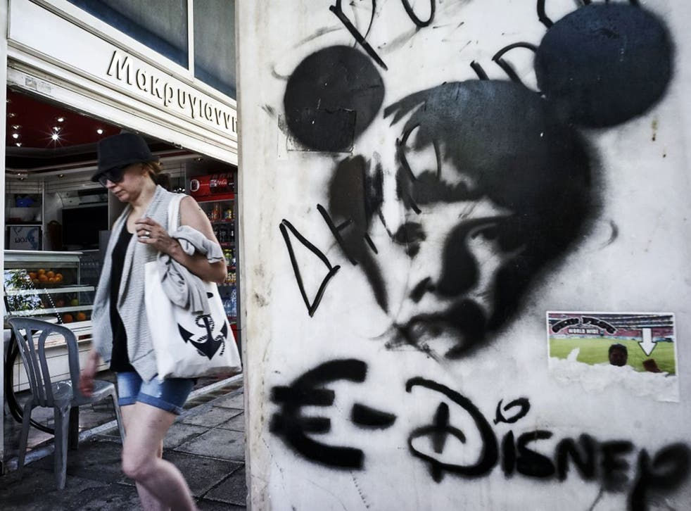 Graffiti in Athens takes a dim view of Angela Merkel and the euro; Greece is now back in recession (Getty)