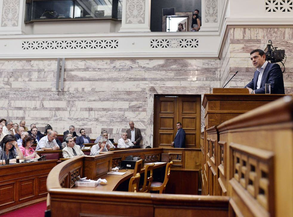 Tspiras addresses a parliamentary group meeting at the Greek Parliament in Athens on June 16, 2015
