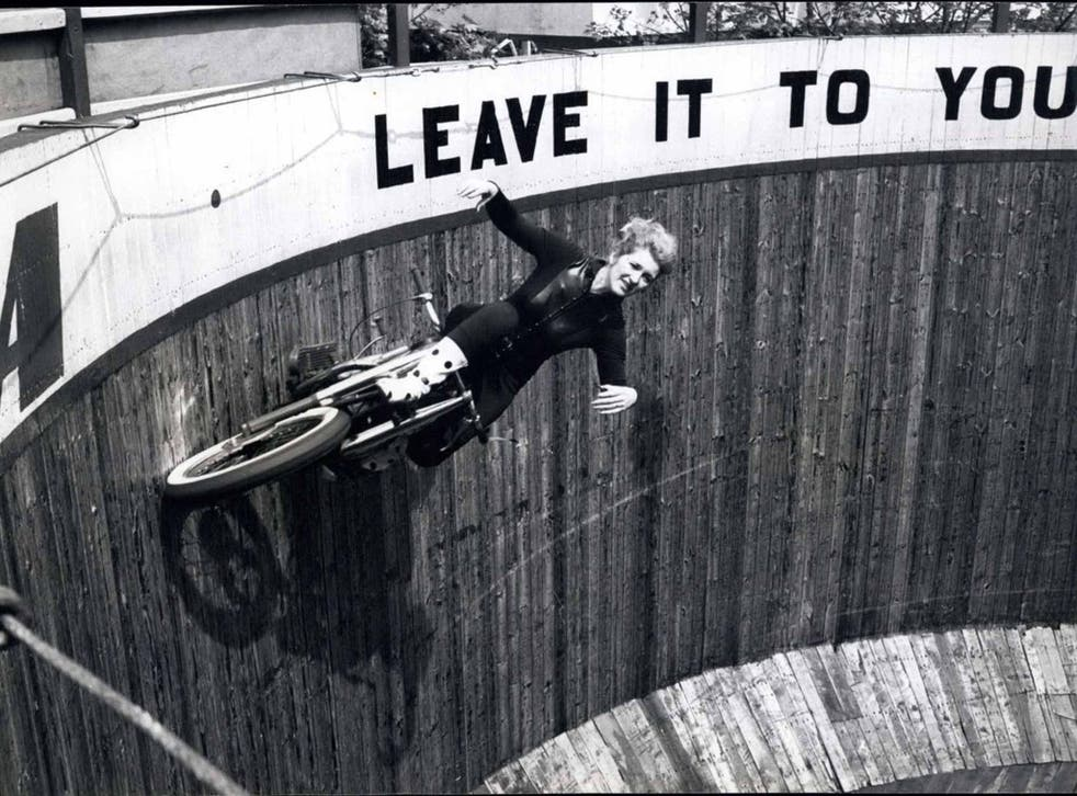 Lady in danger: Yvonne Stagg, who once rode the Wall of Death the day before she was due to give birth, doing what she did best