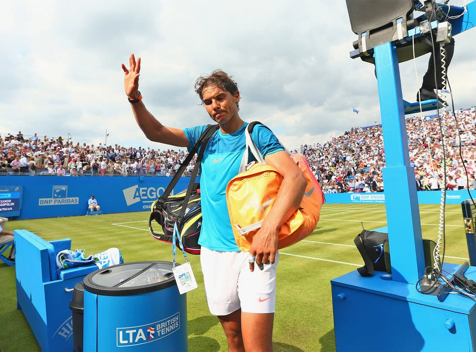 Rafael Nadal waves to the crowd at Queen's Club after his first-round exit at the hands of unseeded Alexandr Dolgopolov