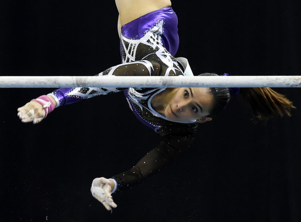 Malaysia's Farah Ann Abdul Hadi competes on the uneven bars during the women's individual all-around gymnastics final at the SEA Games, where she took home six medals, including two golds