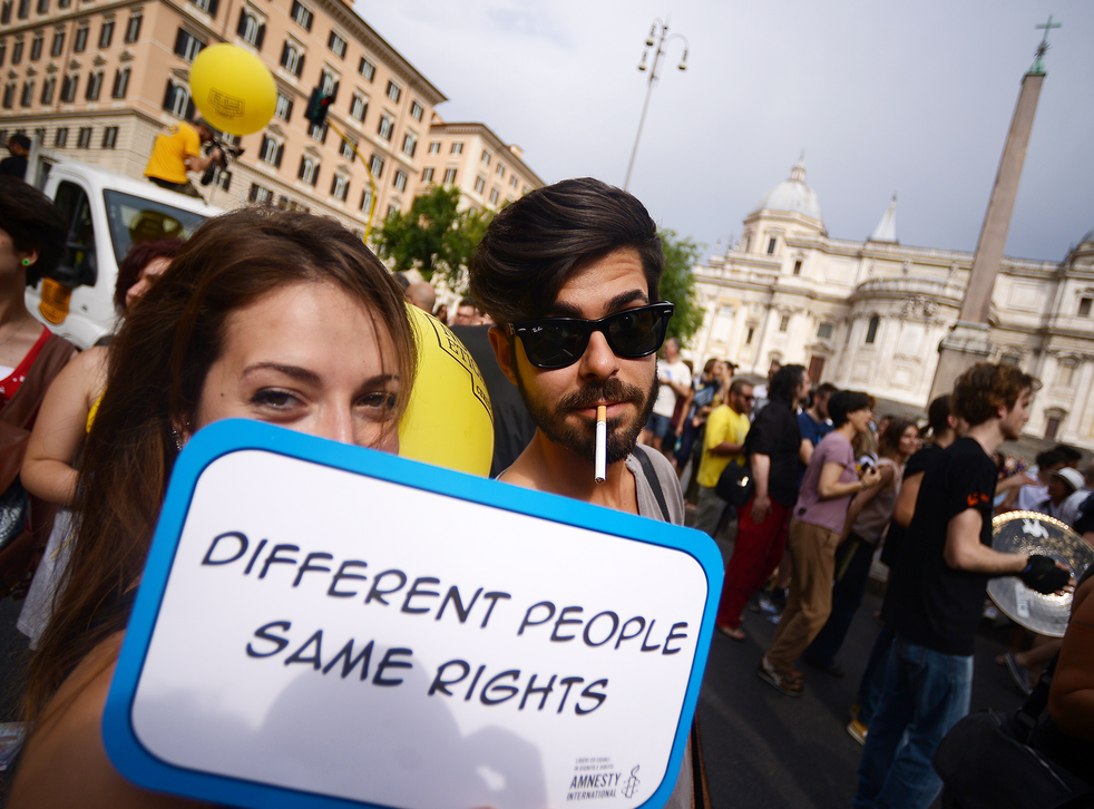 """""""How the world has flipped on its axis when right-wingers are asking to march in gay pride and gay activists are banning them"""" People take part in Rome's Pride Parade, June 13, 2015"""