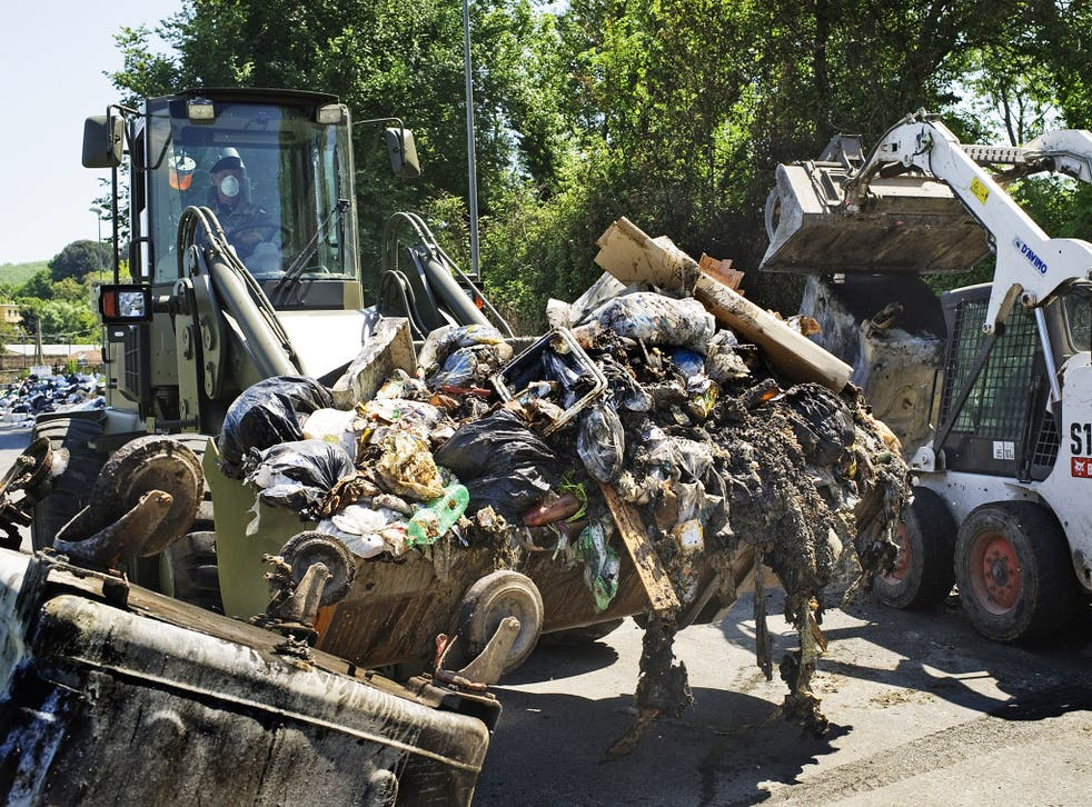 Italian soldiers collect garbage in a street near Naples in 2011. The region has long been dogged by waste disposal issues
