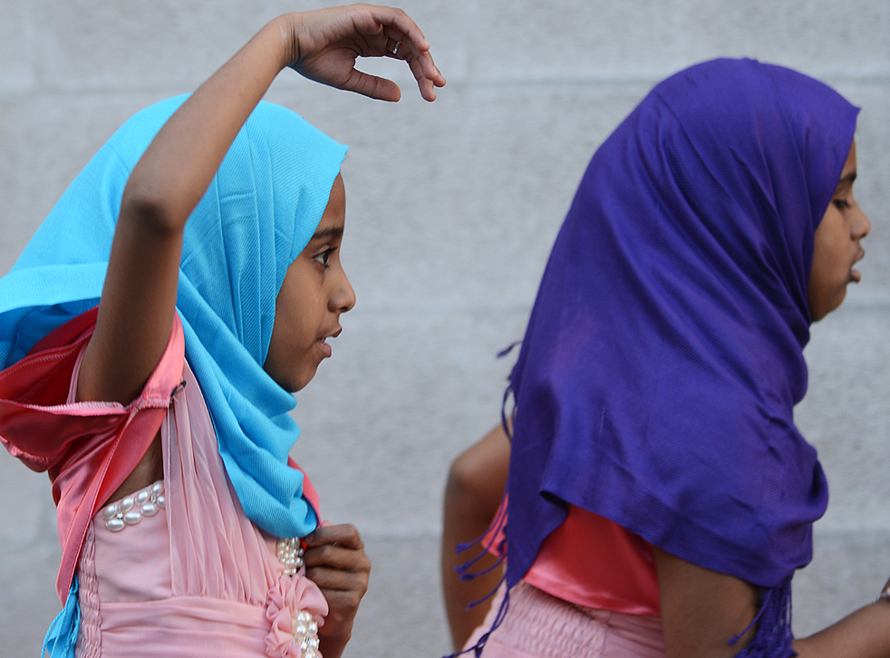 Young girls run at Regent's Park Mosque in London after attending prayers