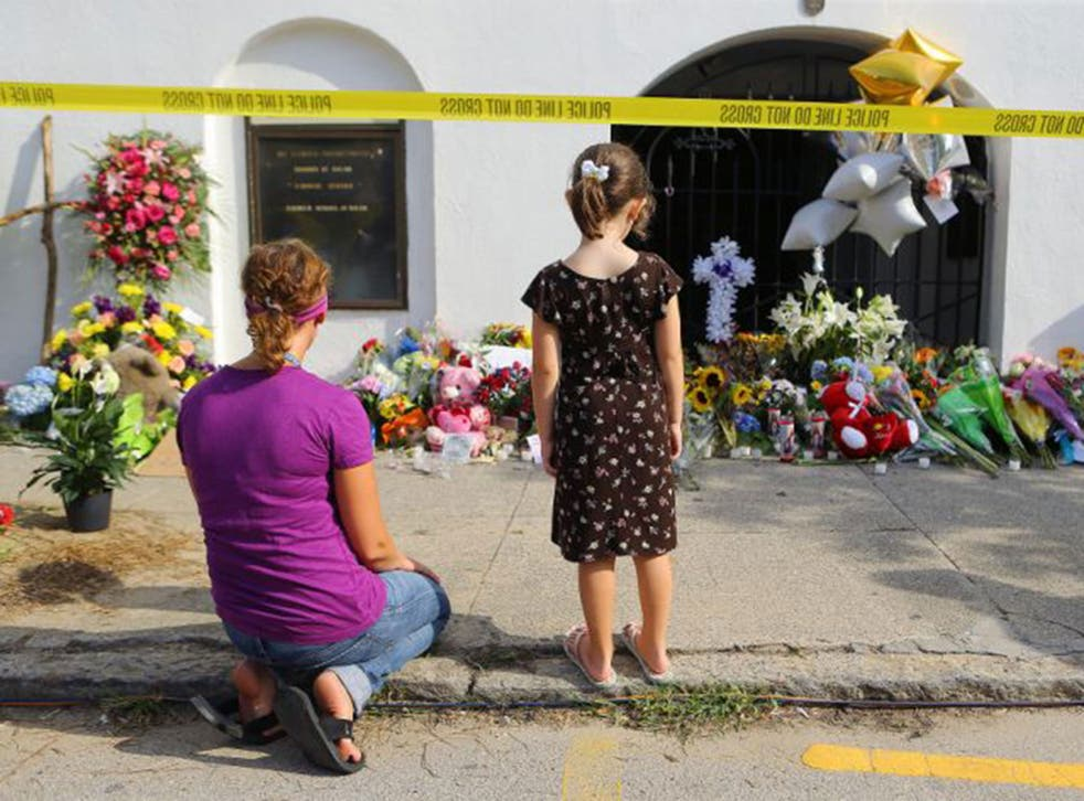 Mourners gather outside of Emauel AME church