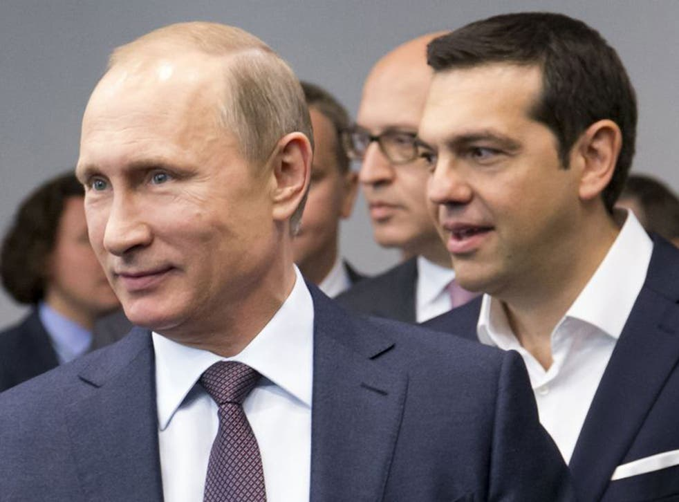 Russian President Vladimir Putin, foreground, and Greek Prime Minister, behind him, Alexis Tsipras arrive for their talks at the St. Petersburg International Investment Forum in St.Petersburg, Russia, Friday, June 19, 2015.