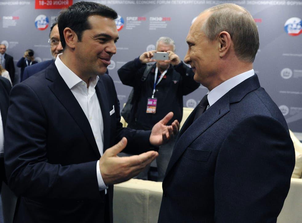 President Vladimir Putin (right) speaks with Greek Prime Minister Alexis Tsipras prior to talks yesterday