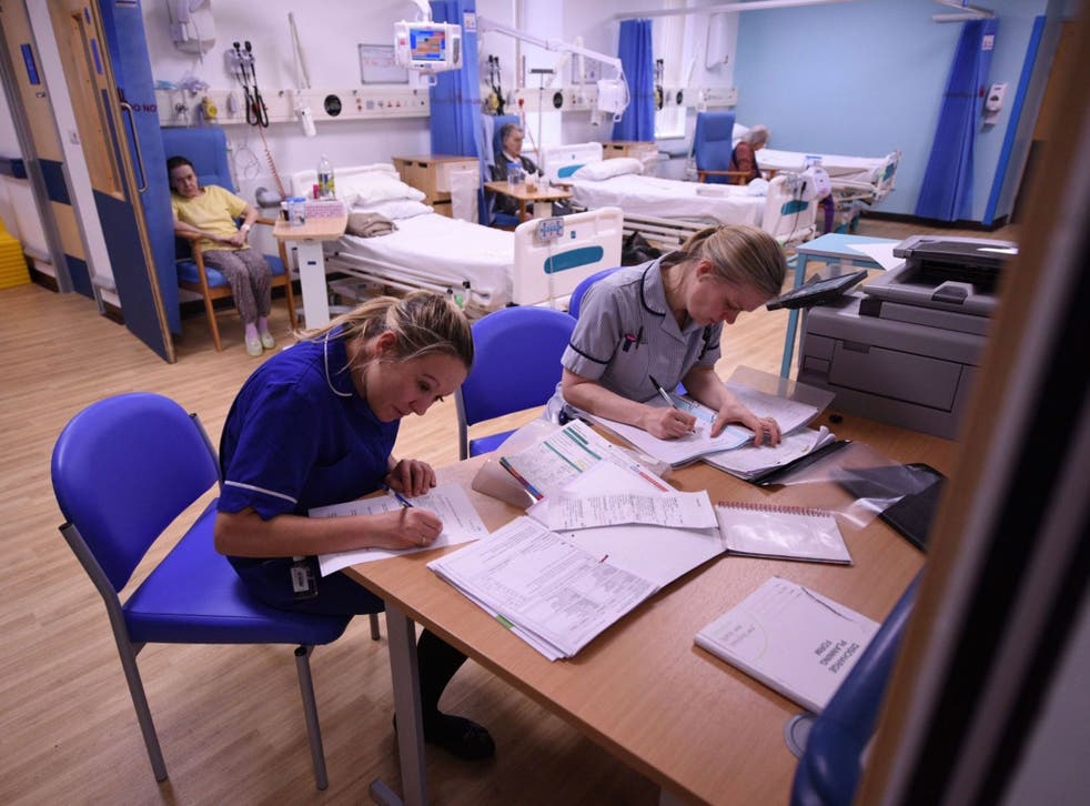Members of clinical staff complete paperwork in the Accident and Emergency department of the 'Royal Albert Edward Infirmary' in Wigan
