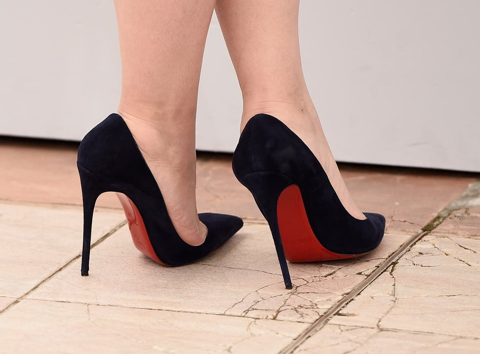 The receptionist says she was shocked when she arrived for her first day at work and was told she had to wear 2 to 4 inch heels