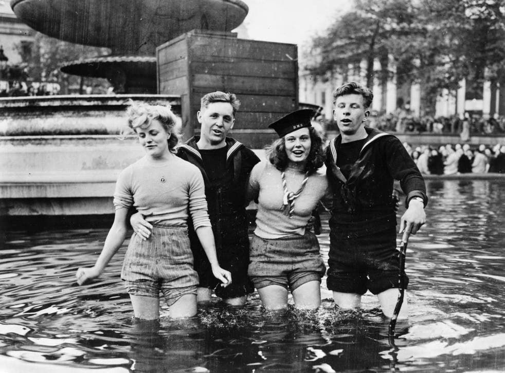 Joyce Digney (nee Brookes), left, with Cynthia Covello, celebrating VE Day with sailors in a fountain at Trafalgar Square on May 8 1945. Joyce Digney is now 89 and living in Canada