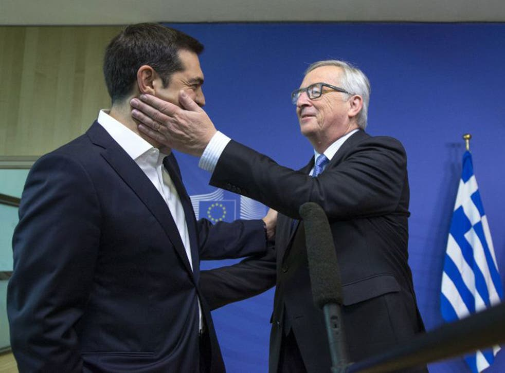 Greek Prime Minister Alexis Tsipras is welcomed by European Commission President Jean-Claude Juncker for a meeting ahead of a Eurozone emergency summit on Greece in Brussels, Belgium June 22.