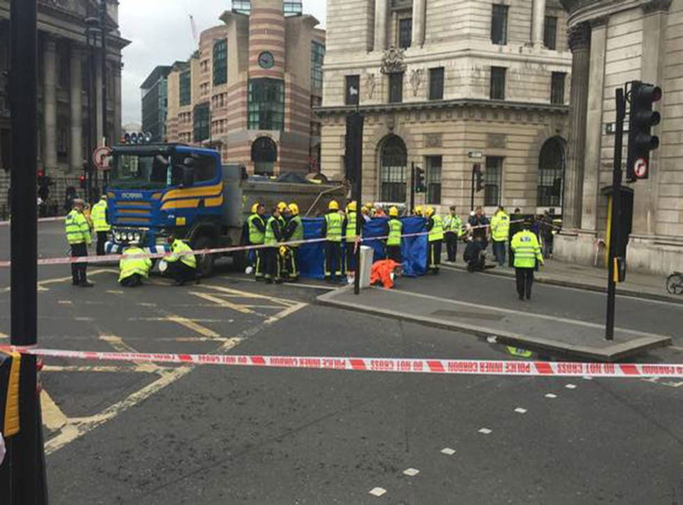 The woman, 26, has died after her bike collided with a tipper truck near the Bank of England