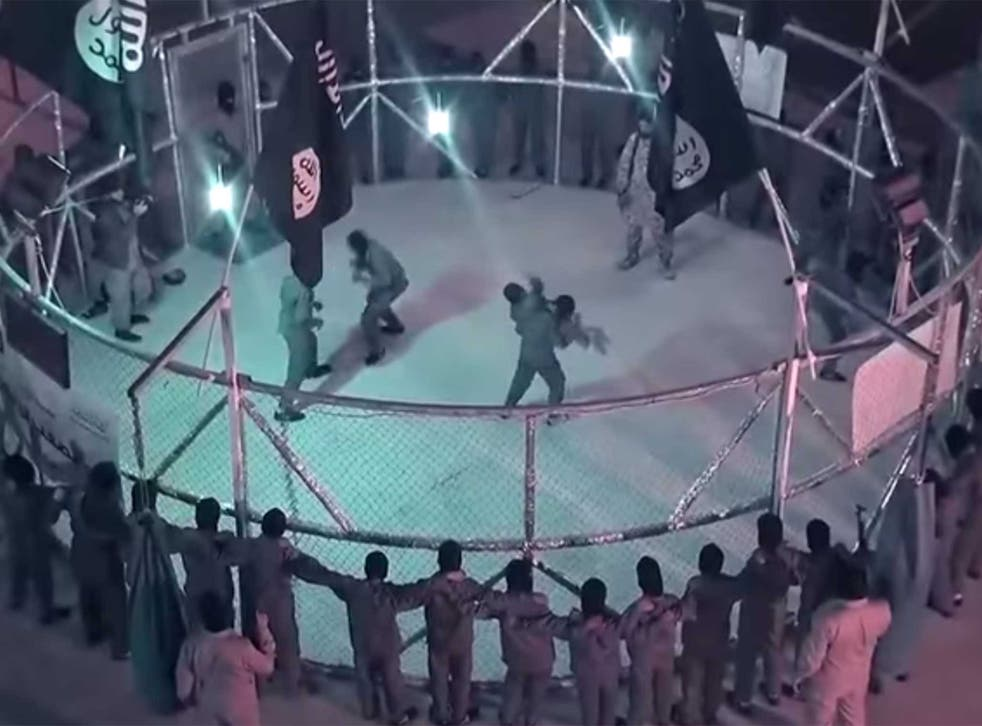The video shows young boys fighting under the direction of an older militant