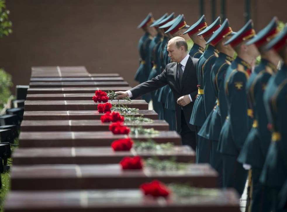 Vladimir Putin takes part in a wreath laying ceremony at the Tomb of the Unknown Soldier outside Moscow on Monday