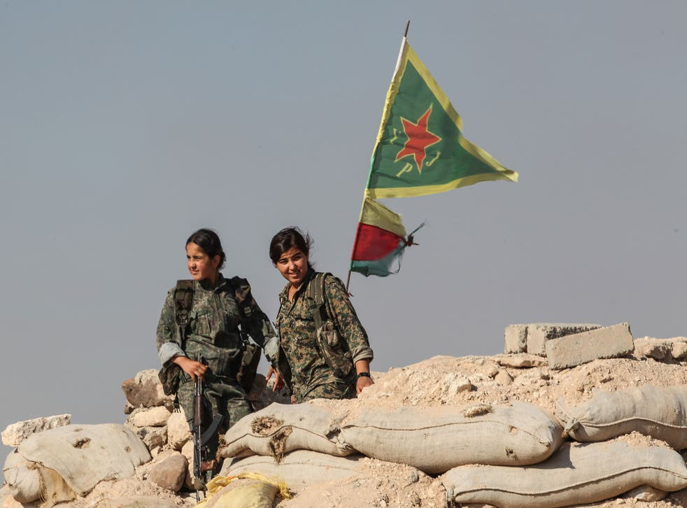 Kurdish YPG fighters pictured near the Northern Syrian town of Kobane (Getty)
