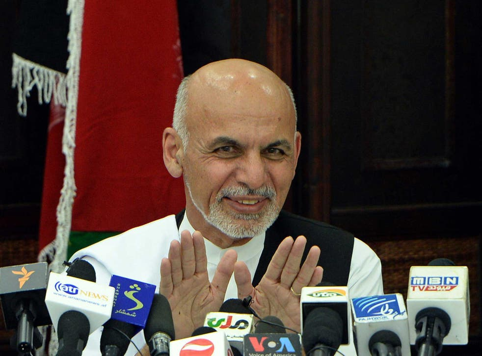 Ashraf Ghani, pictured here during his election campaign, has commended a soldier following the attack on parliament