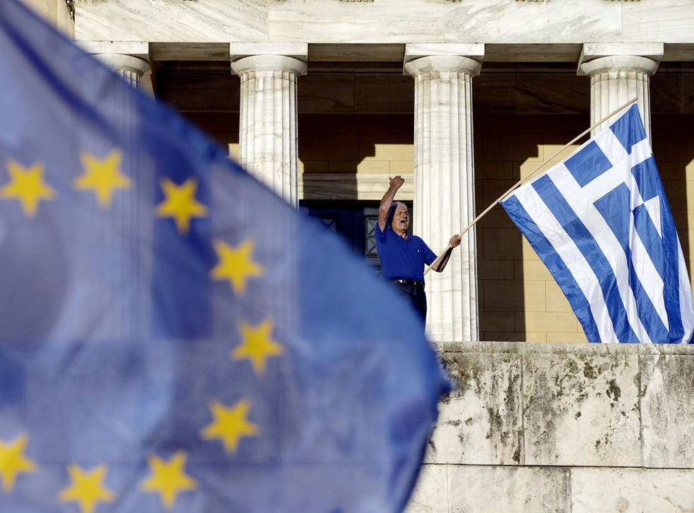A protester shouts slogans during a pro-European demonstration in front of the Greek parliament in Athens. Greece's international lenders raised hopes for a vital bailout agreement to save Athens from default and a possible euro exit, despite warning no d