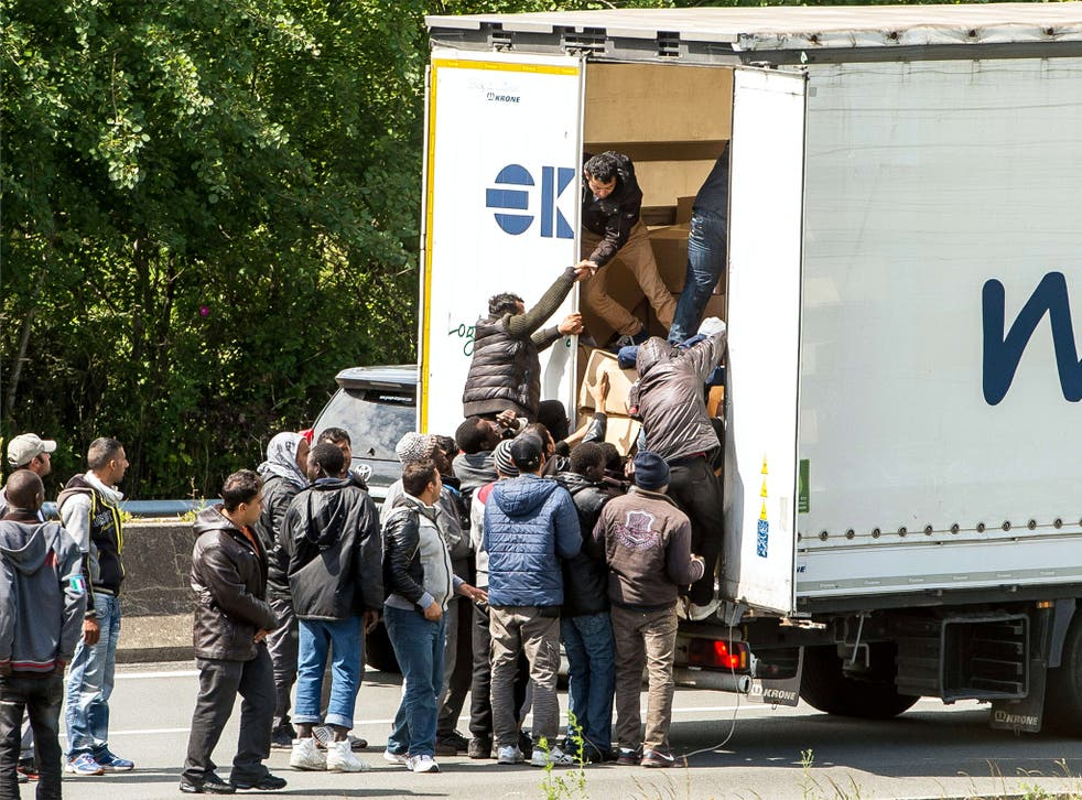 'Worse than it has ever been': migrants climbing into the back of a lorry on the A16 highway in northern France leading to the Channel Tunnel on Tuesday
