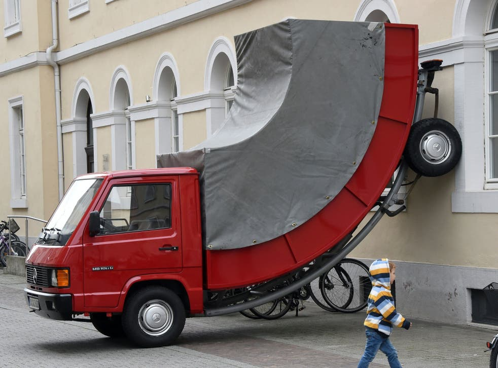 The sculpture, placed outside the Centre for Art and Media in the German city of Karlsruhe, was given a joke parking ticket by a mischievous warden