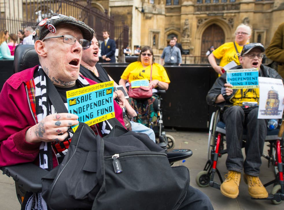 Disability rights campaigners protest outside the Houses of Parliament