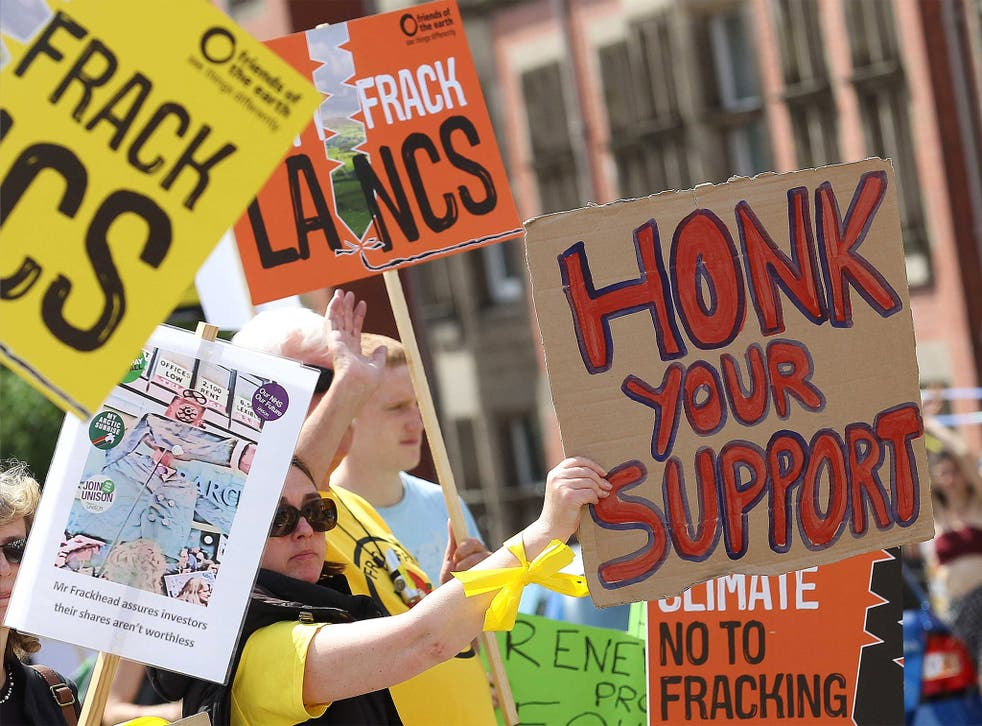Anti-fracking protesters state their case during a demonstration outside of a meeting in Preston County Hall