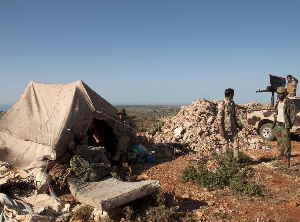 Members of the Libyan pro-government forces, stand near their tent during their deployment in the Lamluda area, southwest of the city of Derna, Libya June 16, 2015
