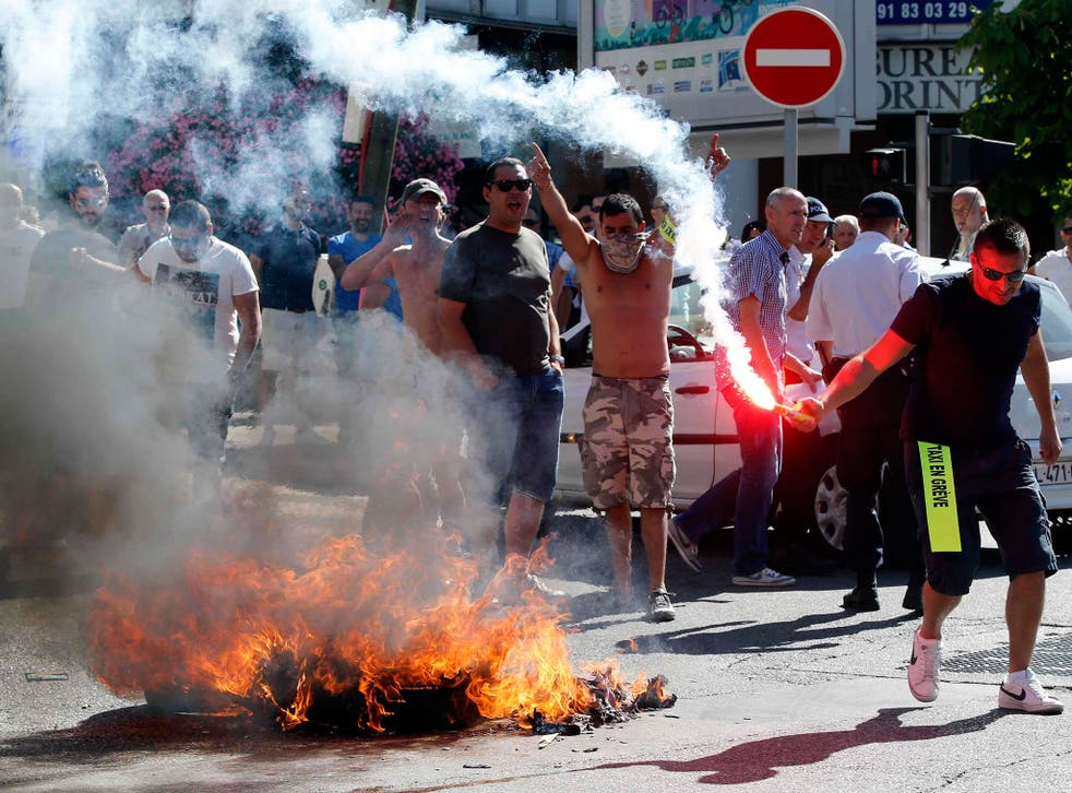 Taxi drivers on strike burn tyres during a national protest against car-sharing service Uber in Marseille, France. French taxi drivers stepped up protests against U.S. online cab service UberPOP, blocking road access to airports and train stations in Pari
