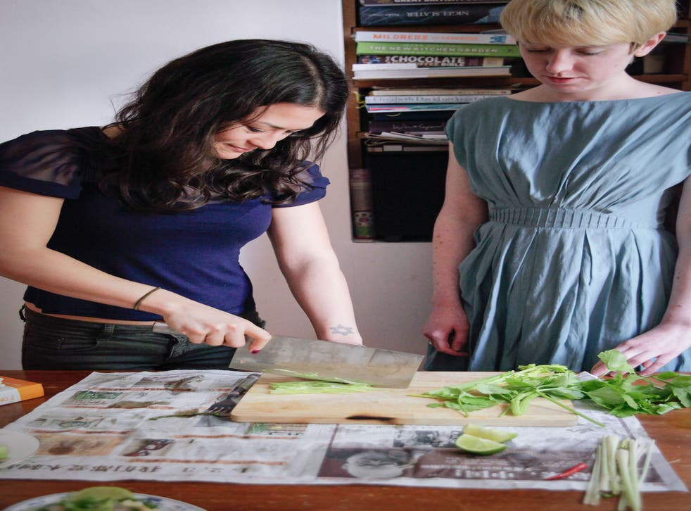 Lizzie Mabbott gives Holly a lesson in using a cleaver