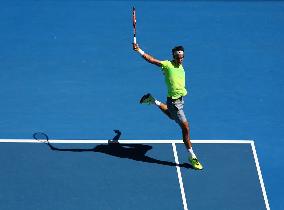 Roger Federer plays a backhand at the 2015 Australian Open in January