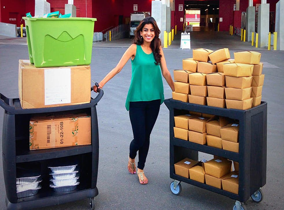 Ms Ahmad with some of the surplus food she's helped give to the homeless