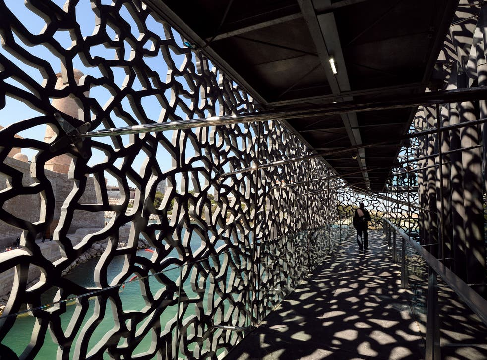 A person walks on June 3, 2013 in a passageway of the MuCEM, the Museum of Civilisations from Europe and the Mediterranean in Marseille on the eve of its opening by the French President