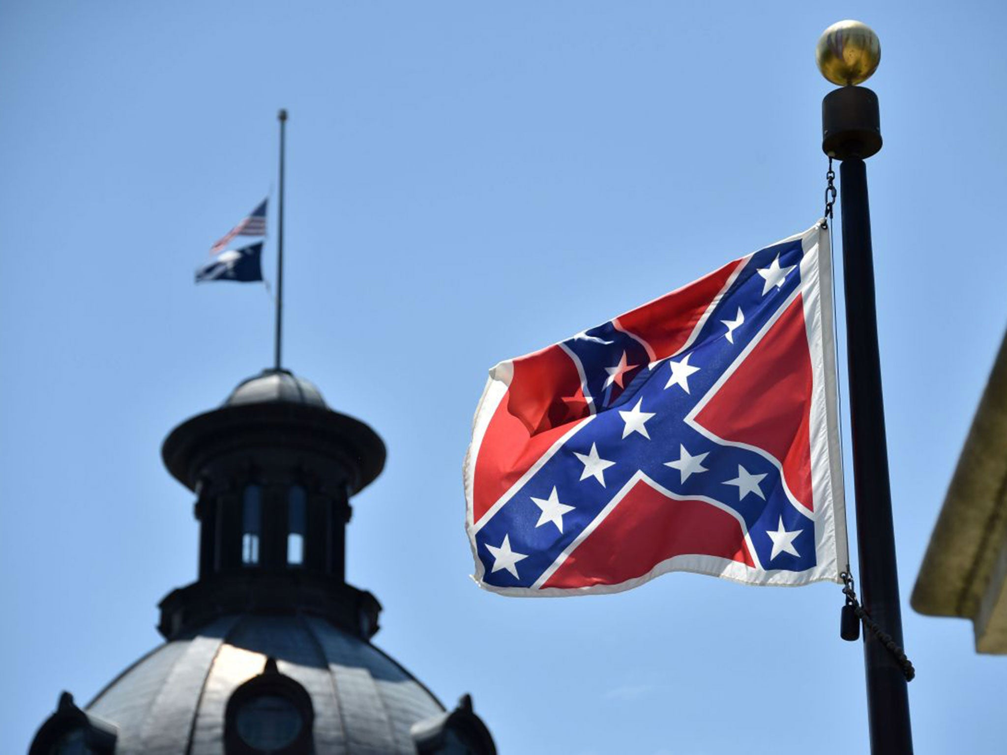 a discussion about the decision by the south carolina to raise a confederate flag atop the statehous