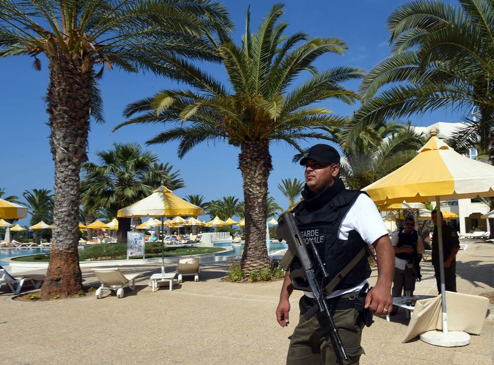 A Tunisian security member stands next to a swimming pool at the resort town of Sousse following a shooting attack