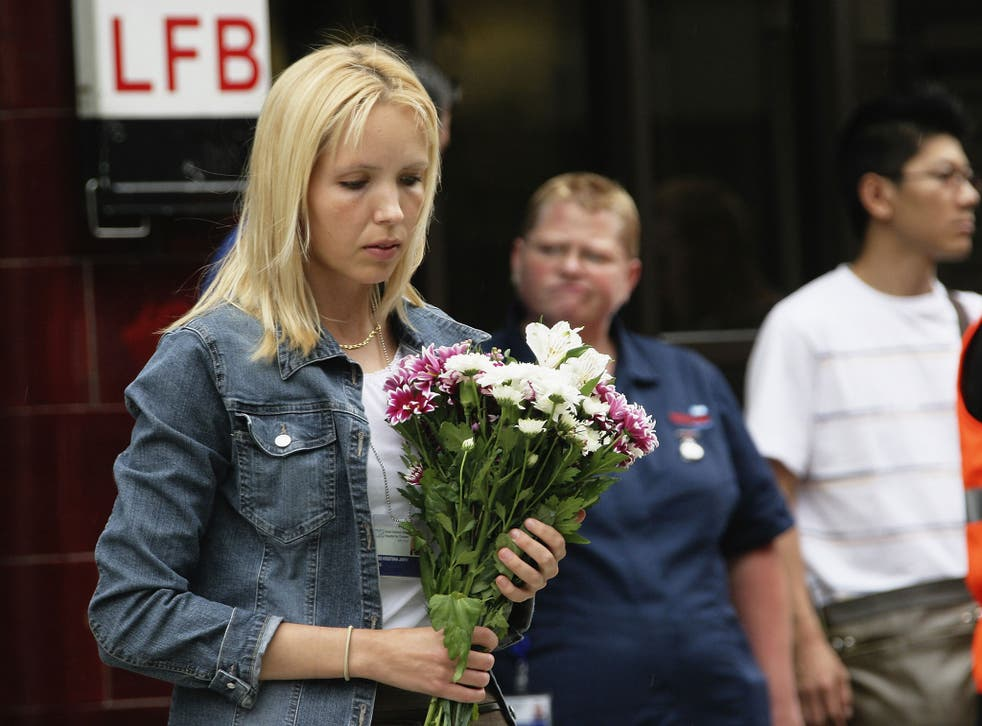 A mourner lays flowers to remember the victims of 7/7 bombings at Russell Square underground station on July 7, 2006 in London, England.
