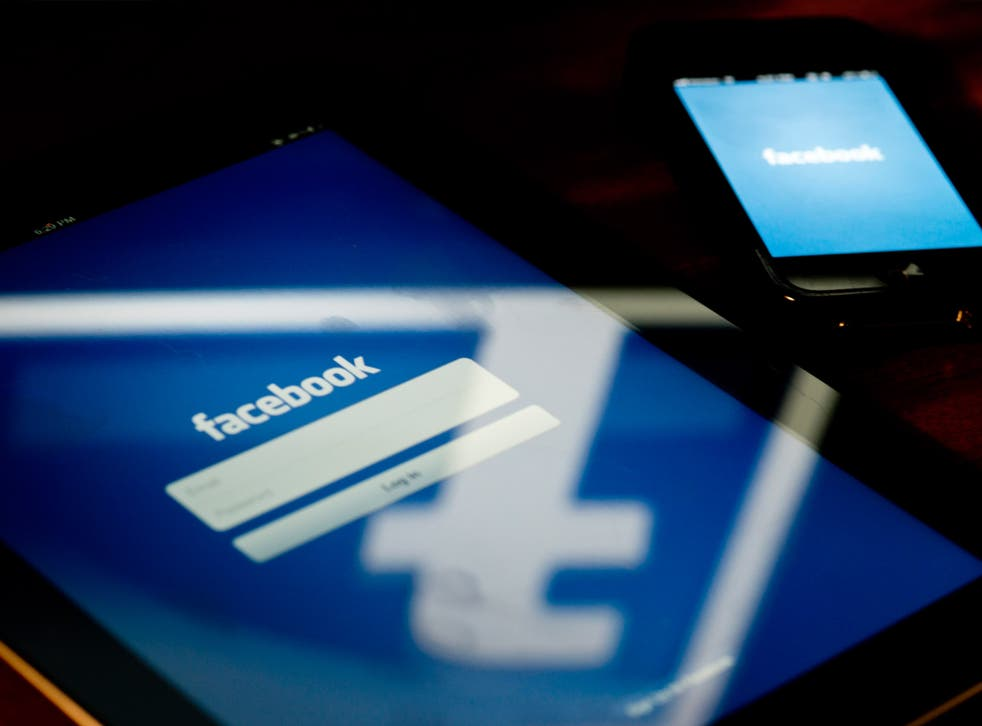 A view of an Apple iPad and iPhone displaying the Facebook app's splash screen 10 May 2012 in Washington, DC
