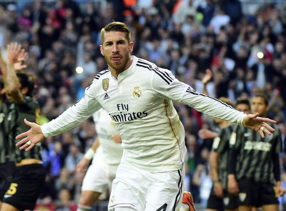 Real Madrid's Sergio Ramos celebrates after scoring against Malaga FC