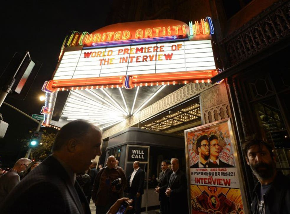 """Heavy security surrounds the entrance of United Artists theater during the premiere of the film """"The Interview"""" in Los Angeles"""