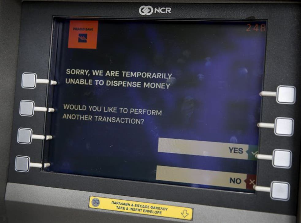 The message displayed on the monitor of a Piraeus Bank ATM in Athens. The Bank of Greece has recommended imposing restrictions on bank withdrawals