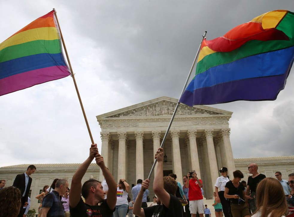 People celebrate in front of the U.S. Supreme Court after the ruling in favor of same-sex marriage June 26, 2015 in Washington, DC