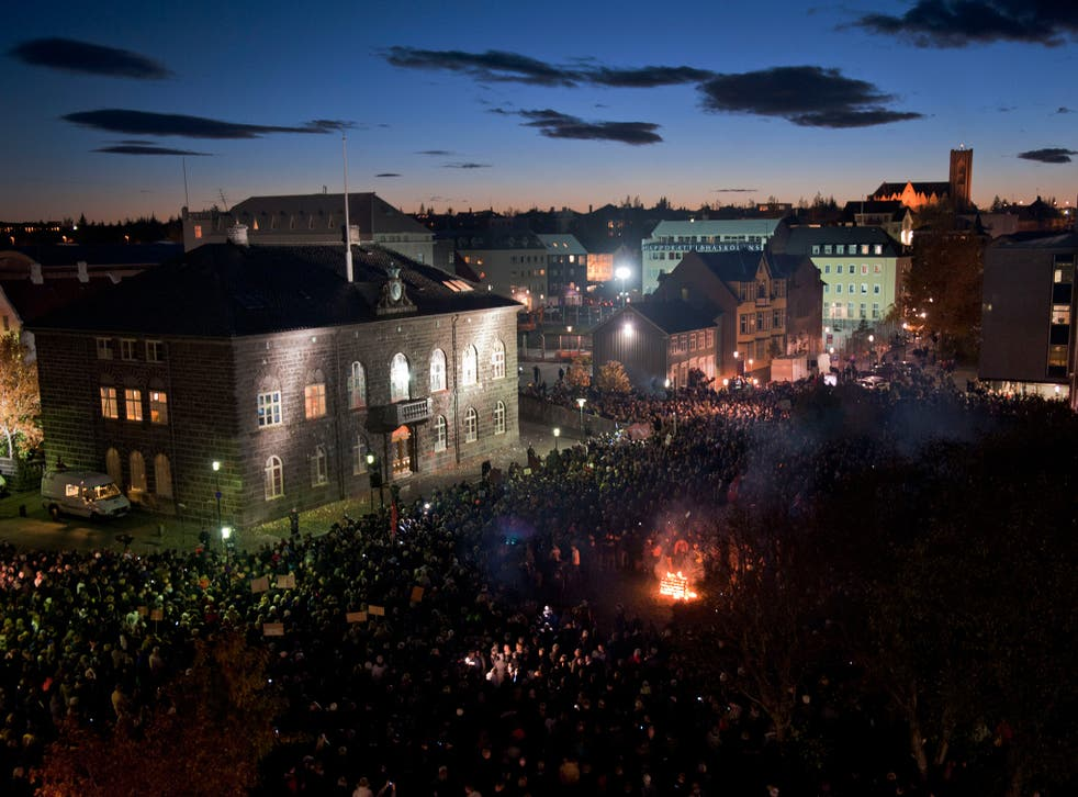 A crowd of people outside parliament in Iceland in 2010