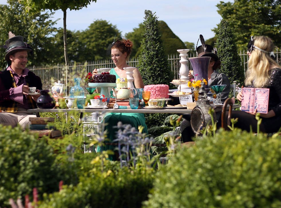An 'Alice in Wonderland' garden at Hampton Court Palace Flower Show in Surrey