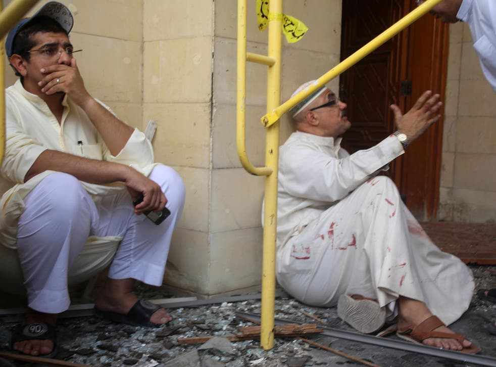 Two men react to the chaos caused by Friday's suicide bombing