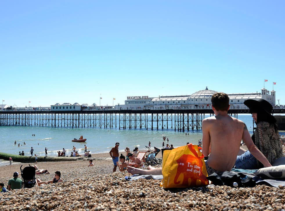 Sunbathers enjoy the hot weather on the beach in Brighton